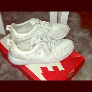 All white Nike Roshe Ones